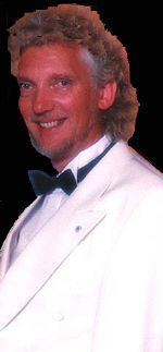 Robert Freeman in typical costume for corporate magic, close-up magic and cruises.