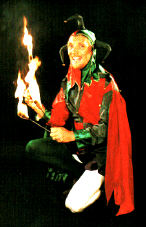 The Jolly Jester in classical jester costume shown here with fire clubs ready to do a show at Hatfield House